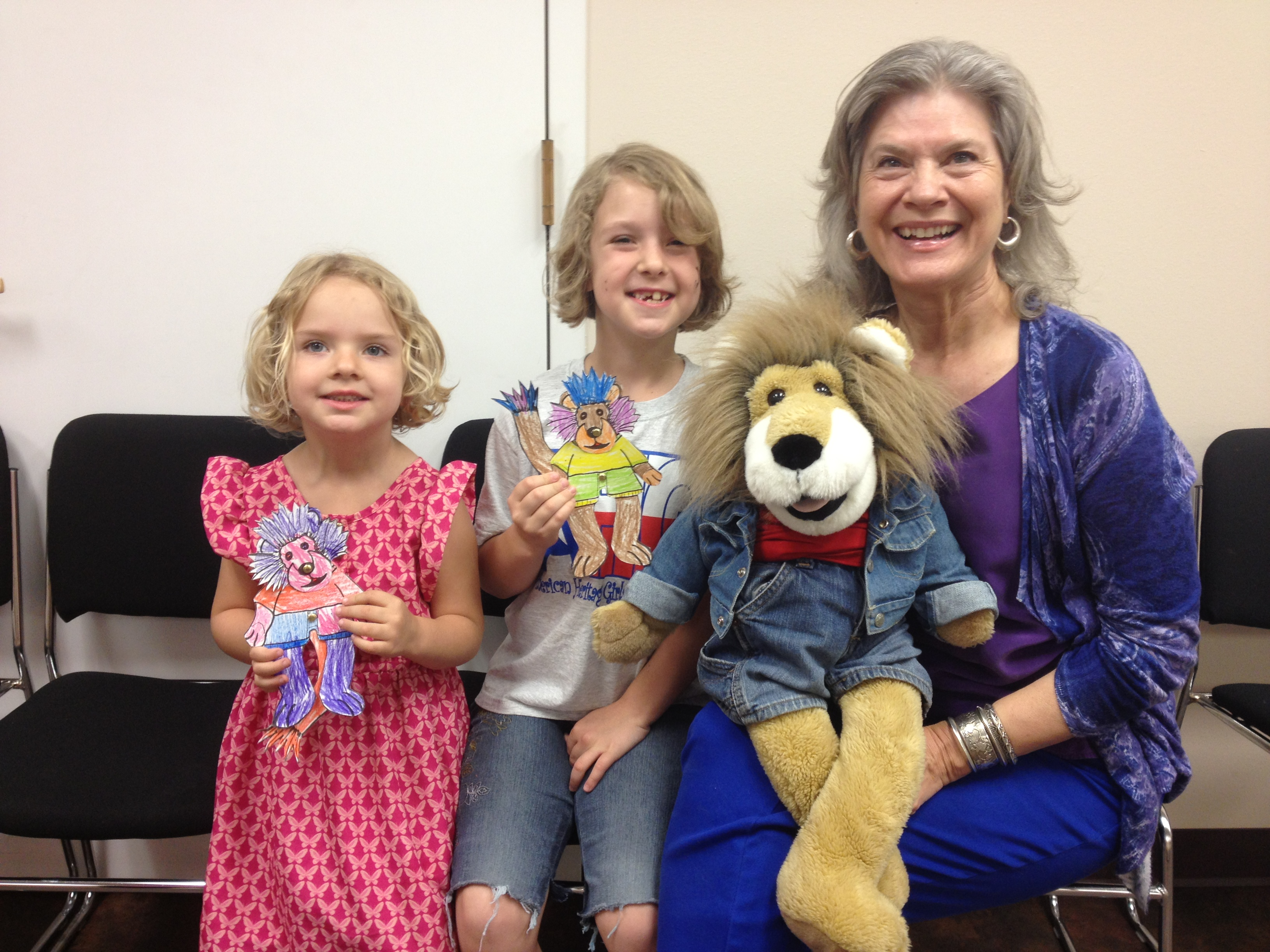 Ella and Hannah and their puppets pose with us.