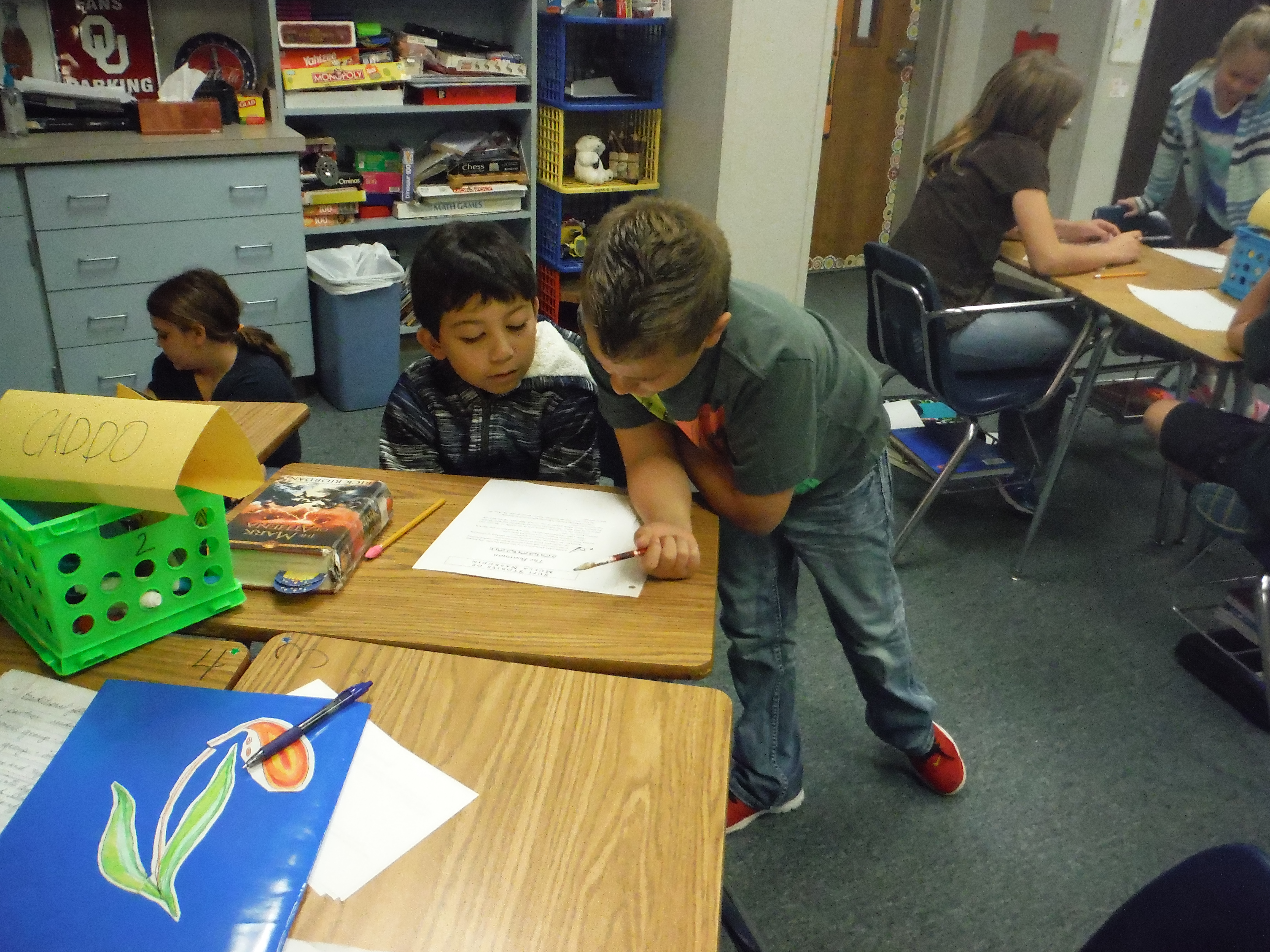 Students read with a partner to adapt and solve a riddle tale.