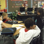 Students work in groups of 4 to retell a story.